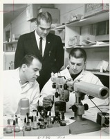 Professor Observing Students in a Lab