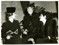 Mildred Pepper with two women at a luncheon