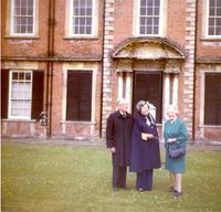 Claude and Mildred Pepper standing in front of a house
