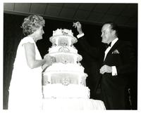 Bob and Dolores Hope cutting an anniversary cake at the Bob Hope benefit dinner