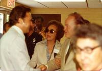 Bob Hope and Mildred Pepper talking to people in a crowd