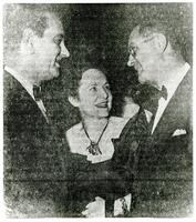 Copy of newspaper photo of Mildred Pepper talking to two men