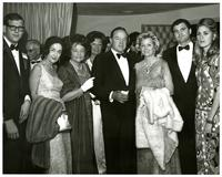 Bob Hope and Mildred Pepper posing with several people