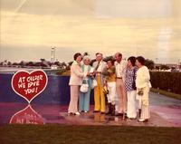 Mildred Pepper posing with jockey and others at the Calder Race Course Sunny Isles Handicap