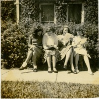 Nancy, Johan, Mary Ann, and Lillian Reading Papers Outside