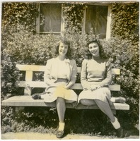 Patricia Lowry and Nancy Smith Sitting on a Bench Outside