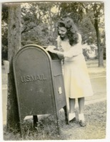 Nancy Smith Dropping Off Mail at a Mail Box