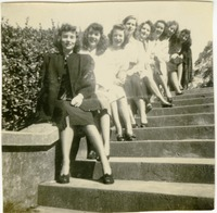 Students Sitting on a Stair Railing Outside