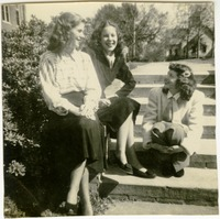 Students Sitting on Steps on Campus