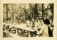 Group of People at a Picnic Table