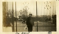 Mr. Elliot Standing Next to Gate