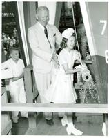 Young girl christening the USS Miami